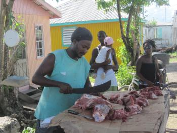 butchering meat on the street