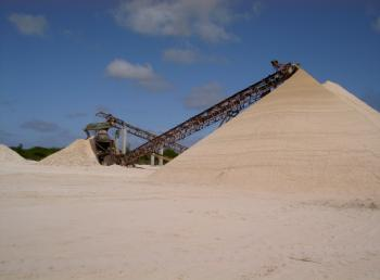 Sand stored in large heaps ready for shipment