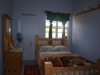 A bedroom at the Island Guest House